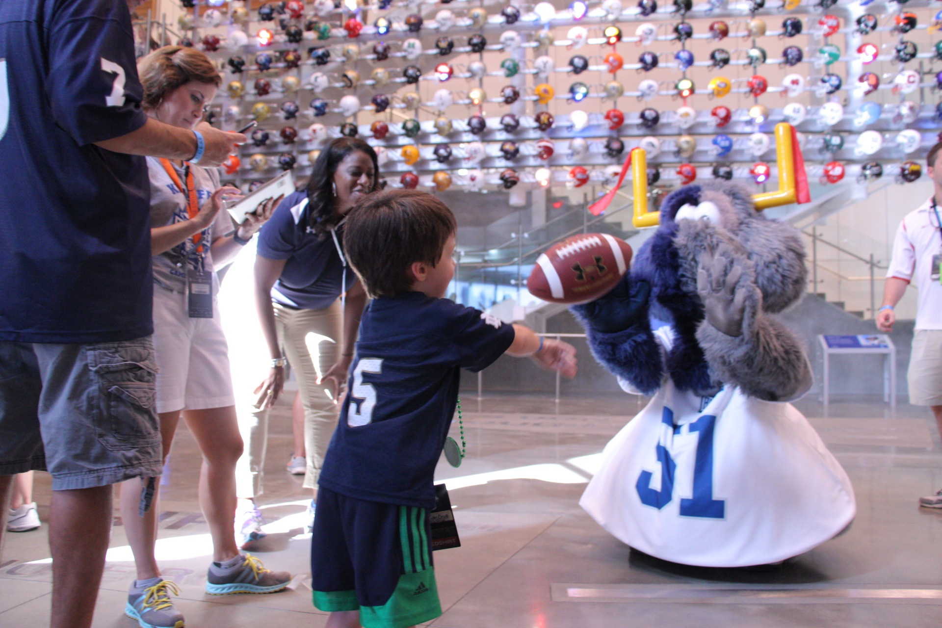Fumbles plays catch with young fan.JPG